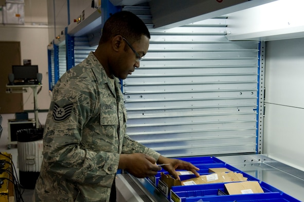 JOINT BASE ELMENDORF-RICHARDSON, Alaska -- Tech. Sgt Calvin Bradley, a material handler with the 176th Logistics Readiness Squadron, pulls aircraft supplies from cabinets, March 19, 2011. The squadron recently moved -- along with its parent unit, the 176th Wing -- from Kulis Air National Guard Base to Joint Base Elmendorf-Richardson per the 2005 Defense Base Closure and Realignment proposal. During the move, the wing and its units continued to maintain their day-to-day operations. Alaska Air National Guard photo by Master Sgt. Shannon Oleson.