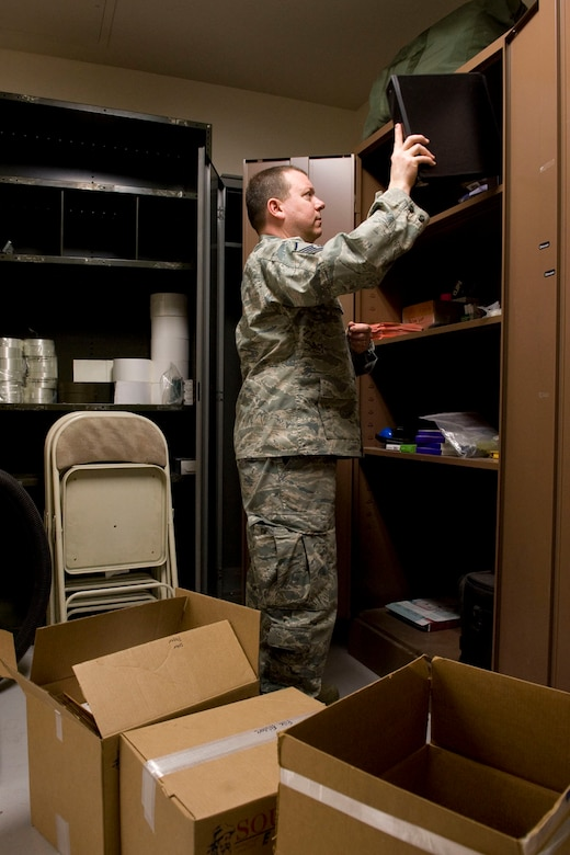 JOINT BASE ELMENDORF-RICHARDSON, Alaska -- Master Sgt. Jack Parks, a member of the 176th Logistics Readiness Squadron's Traffic Management Office, stocks office supplies in cabinets here March 19, 2011. The squadron recently moved (along with its parent unit, the 176th Wing) from Kulis Air National Guard Base to Joint Base Elmendorf-Richardson per the 2005 Defense Base Realignment and Closure proposal. Alasa Air National Guard photo by Master Sgt. Shannon Oleson.