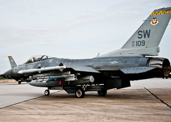 An F-16 Fighting Falcon loaded with a Guided Bomb Unit-12 from the 20th Fighter Wing waits to taxi out for a sortie March 14 at Eglin Air Force Base, Fla.  More than 10 F-16s from the 20th Fighter Wing were on hand to participate in the air-to-ground weapons system evaluation program known as Combat Hammer at Eglin.  The week-long evaluation is conducted by the 86th Fighter Weapons Squadron, located here.  The squadron hosts 20 to 25 evaluations at Hill and Eglin each year, assessing weapon system performance, reliability, capabilities, and limitations in realistic combat scenarios against representative real-world targets.  (U.S. Air Force photo/Samuel King Jr.)