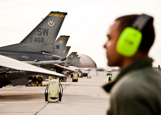 Senior Airman Keith Tunstall, 20th Aircraft Maintenance Squadron, stands as the fire guard assistant during an F-16s flight checks March 14 at Eglin Air Force Base, Fla.   More than 10 F-16s from the 20th Fighter Wing were on hand to participate in the air-to-ground weapons system evaluation program known as Combat Hammer at Eglin.  The week-long evaluation is conducted by the 86th Fighter Weapons Squadron, located here.  The squadron hosts 20 to 25 evaluations at Hill and Eglin each year, assessing weapon system performance, reliability, capabilities, and limitations in realistic combat scenarios against representative real-world targets.  (U.S. Air Force photo/Samuel King Jr.)