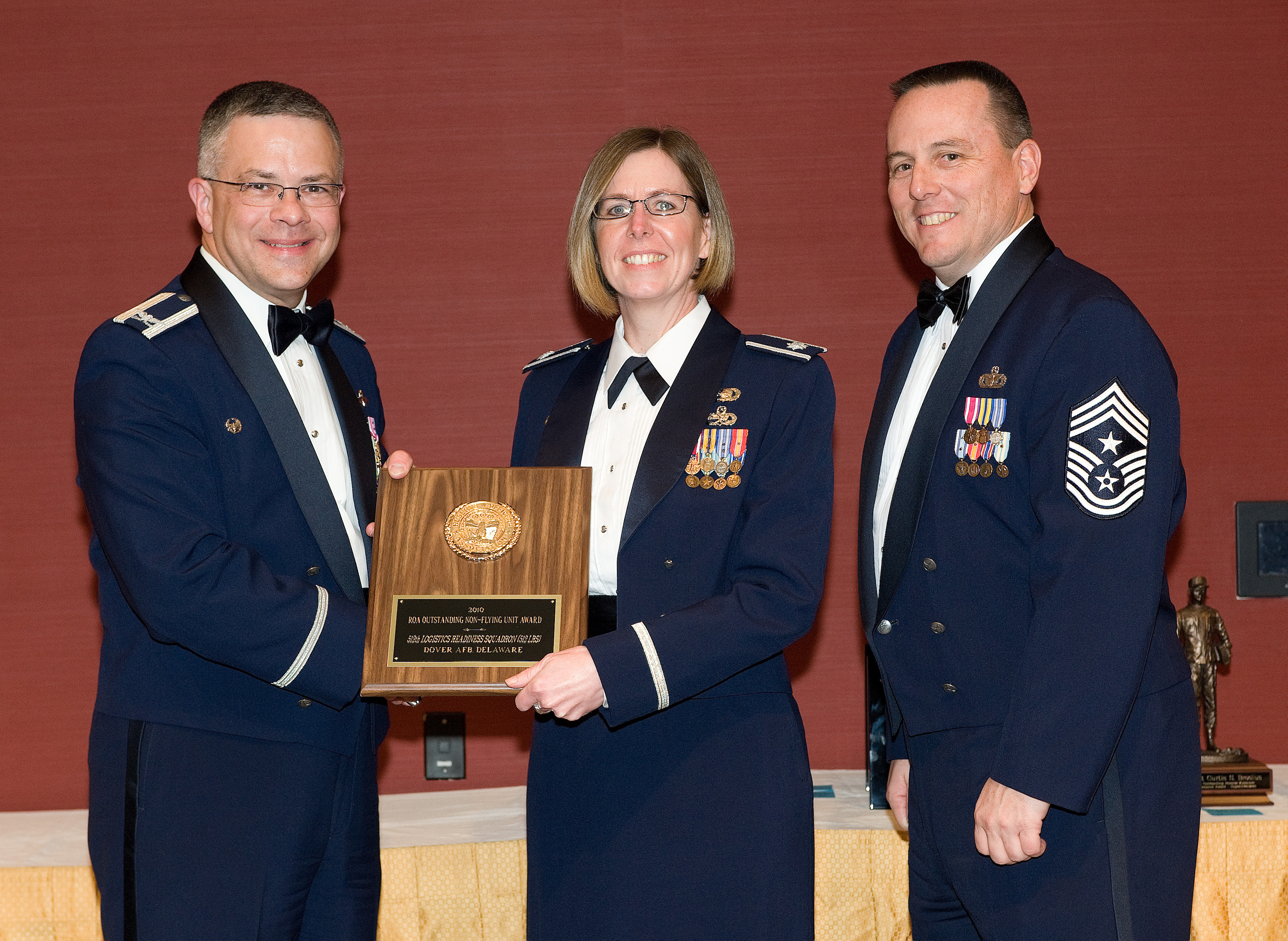 Lt. Col. Gretchen Wiltse, 512th Mission Support Group Commander, Accepts  The The ?