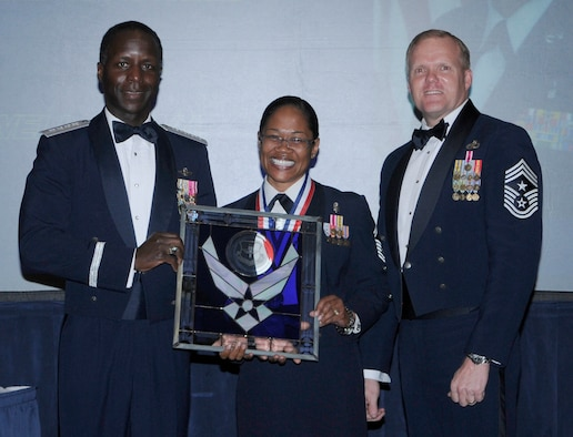 General Edward Rice, Air Education And Training Command commander and Chief Master Sergeant James Cody, Air Education and Training Command , command chief presents award to SMSgt Mauree C. Powell, from Air University, Maxwell Air Force Base Alabama, as First Sergeant Of The Year.  Ceremony was held at the Parr Officer Club at Randolph Air Force Base, Texas on March 18.(U.S. Air Force photo/by Don Lindsey).