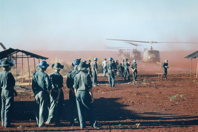 United Nations personnel observe the POW exchange at Loc Ninh, Feb. 1, 1973. (U.S. Air Force photo)