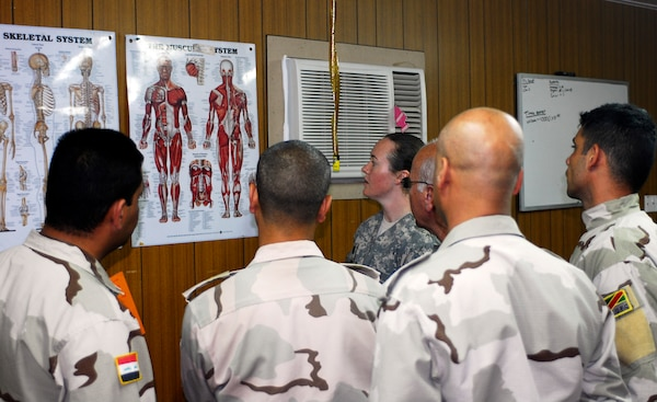 Sarah Baker, center, physical therapist with C Company, 299th