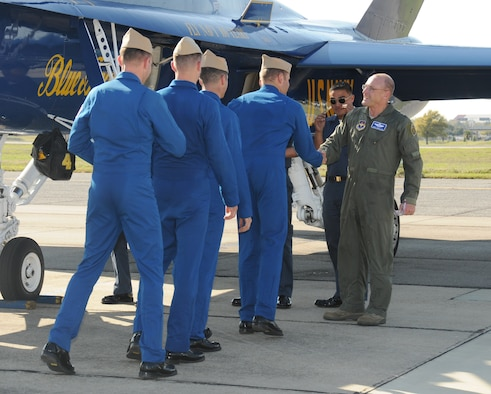 General Mueller, right, greets members of the Navy's Blue Angels team on the Keesler flightline following a practice flight March 18.  (U.S. Air Force photo by Kemberly Groue)