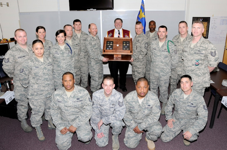 McGHEE TYSON AIR NATIONAL GUARD BASE, Tenn. - Members of NCO Academy Class 11-3, D-flight honor retired Air Force Capt. William A. Robinson, center, the first enlisted POW of the Vietnam War by dedicating their flight room in Morrisey Hall as the Robinson Room in his honor, March 22, 2011.  The center dedicated the room in a tribute to enlisted heroes. (U.S. Air Force photo by Master Sgt. Kurt Skoglund/Released)