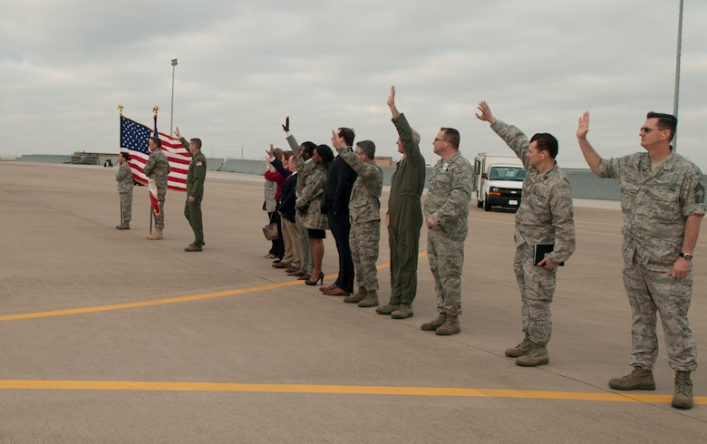 Members of the 136th Airlift Wing and elected official representatives wave good bye to deploying members aboard the wing's C-130H aircraft headed for Afghanistan from NAS Fort Worth JRB, Texas, March 18, 2011. The 136th Airlift Wing, in support of Operation ENDURING FREEDOM, has deployed over 1,000 Airmen over the course of 23 Air Expeditionary Force deployments, since 2003. (U.S. Air Force photo by Senior Master Sgt. Elizabeth Gilbert/released)