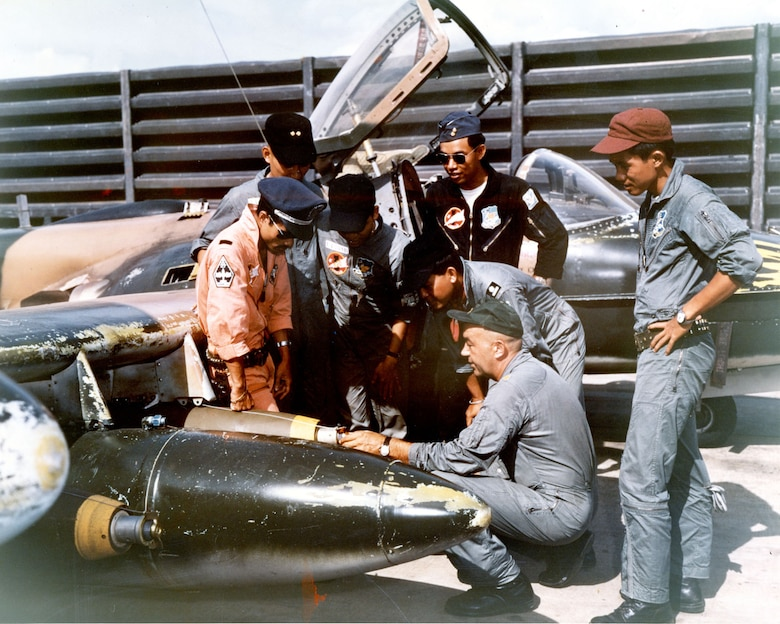 South Vietnamese pilots learn from an American instructor. (U.S. Air Force photo)