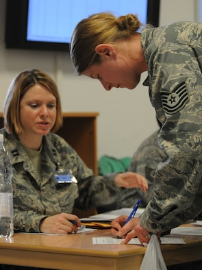 SPANGDAHLEM AIR BASE, Germany – A 52nd Component Maintenance Squadron tech. sgt. signs paperwork as she processes through the personnel deployment function line here before leaving in support of Operation Odyssey Dawn March 20. Joint Task Force Odyssey Dawn is the U.S. Africa Command task force established to provide operational and tactical command and control of U.S. military forces supporting the international response to the unrest in Libya and enforcement of United Nations Security Council Resolution (UNSCR) 1973. UNSCR 1973 authorizes all necessary measures to protect civilians in Libya under threat of attack by Qadhafi regime forces.  JTF Odyssey Dawn is commanded by U.S. Navy Admiral Samuel J. Locklear, III. (U.S. Air Force photo/Staff Sgt. Benjamin Wilson)