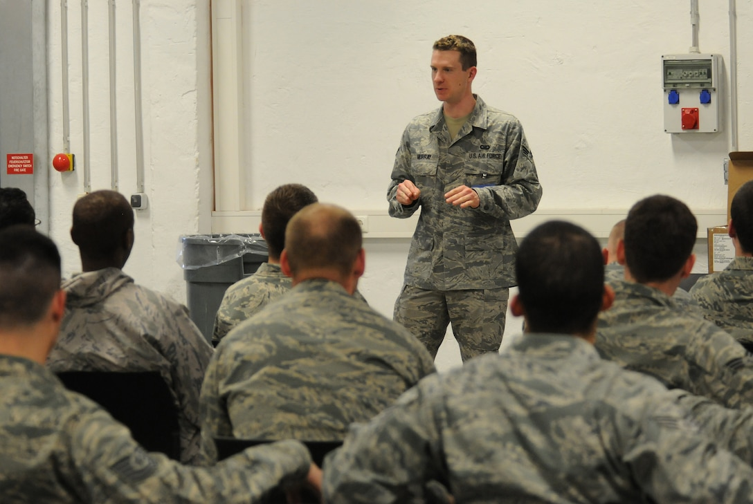SPANGDAHLEM AIR BASE, Germany – Senior Airman Clayton Murray, 52nd Fighter Wing Public Affairs, briefs Airmen here before they deploy in support of Operation Odyssey Dawn March 20. Joint Task Force Odyssey Dawn is the U.S. Africa Command task force established to provide operational and tactical command and control of U.S. military forces supporting the international response to the unrest in Libya and enforcement of United Nations Security Council Resolution (UNSCR) 1973. UNSCR 1973 authorizes all necessary measures to protect civilians in Libya under threat of attack by Qadhafi regime forces.  JTF Odyssey Dawn is commanded by U.S. Navy Admiral Samuel J. Locklear, III. (U.S. Air Force photo/Staff Sgt. Benjamin Wilson)