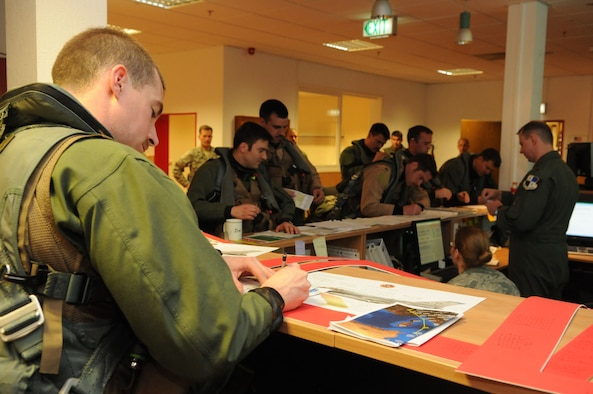 SPANGDAHLEM AIR BASE, Germany – Pilots from the 480th Fighter Squadron receive a briefing at the squadron here before leaving to support of Operation Odyssey Dawn March 19. Joint Task Force Odyssey Dawn is the U.S. Africa Command task force established to provide operational and tactical command and control of U.S. military forces supporting the international response to the unrest in Libya and enforcement of United Nations Security Council Resolution (UNSCR) 1973. UNSCR 1973 authorizes all necessary measures to protect civilians in Libya under threat of attack by Qadhafi regime forces.  JTF Odyssey Dawn is commanded by U.S. Navy Admiral Samuel J. Locklear, III. (U.S. Air Force photo/Staff Sgt. Benjamin Wilson)