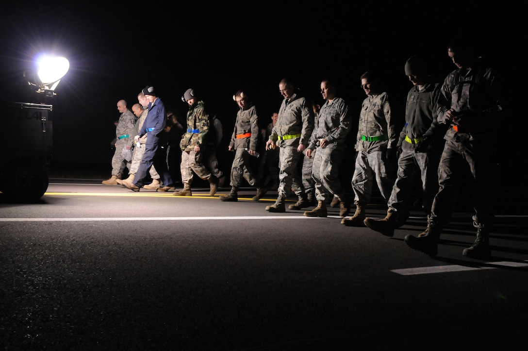 SPANGDAHLEM AIR BASE, Germany – Airmen assigned to the 52nd Maintenance Group perform a foreign objects and debris inspection of a taxi-way in preparation for the take-off of 480th Fighter Squadron F-16 Fighting Falcons in support of Operation Odyssey Dawn March 19. Joint Task Force Odyssey Dawn is the U.S. Africa Command task force established to provide operational and tactical command and control of U.S. military forces supporting the international response to the unrest in Libya and enforcement of United Nations Security Council Resolution (UNSCR) 1973. UNSCR 1973 authorizes all necessary measures to protect civilians in Libya under threat of attack by Qadhafi regime forces.  JTF Odyssey Dawn is commanded by U.S. Navy Admiral Samuel J. Locklear, III. (U.S. Air Force photo/Senior Airman Nathanael Callon)