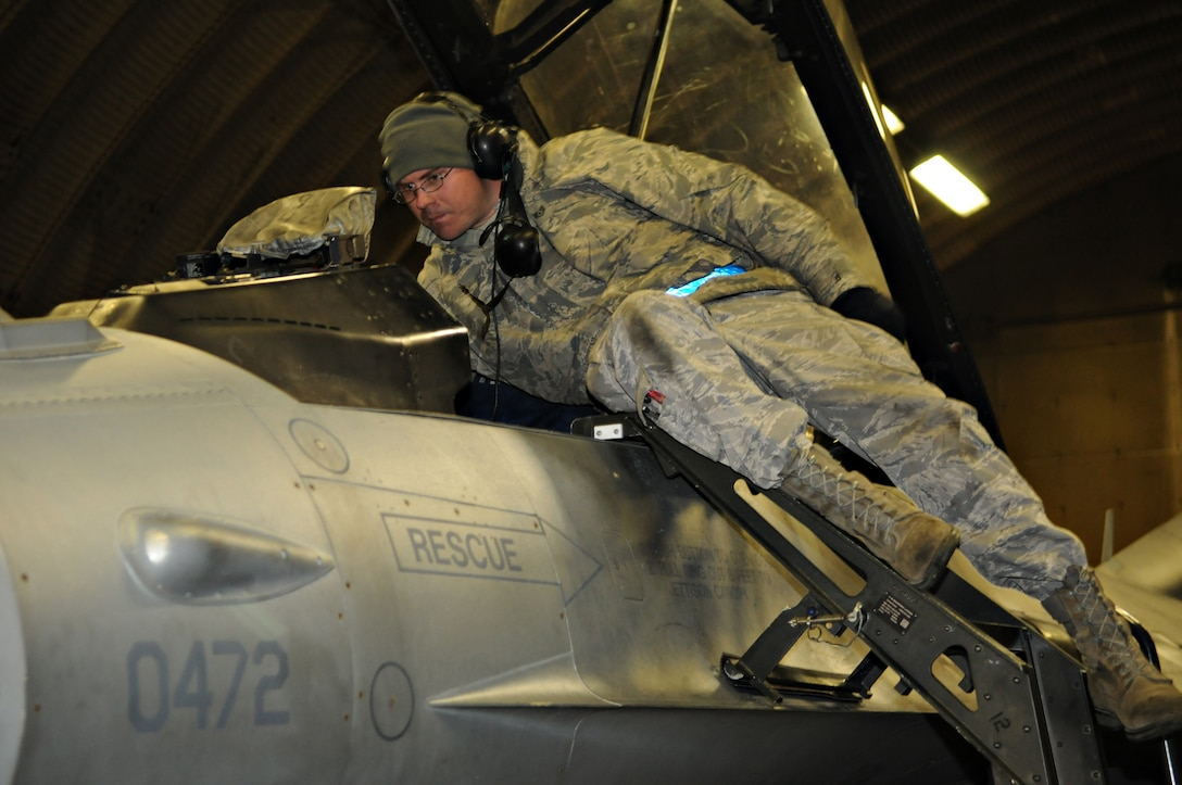 SPANGDAHLEM AIR BASE, Germany – A 52nd Aircraft Maintenance Squadron avionics craftsman rekeys the avionics systems of an F-16 Fighting Falcon here March 18 that will depart in support of Operation Odyssey Dawn. Joint Task Force Odyssey Dawn is the U.S. Africa Command task force established to provide operational and tactical command and control of U.S. military forces supporting the international response to the unrest in Libya and enforcement of United Nations Security Council Resolution (UNSCR) 1973. UNSCR 1973 authorizes all necessary measures to protect civilians in Libya under threat of attack by Qadhafi regime forces.  JTF Odyssey Dawn is commanded by U.S. Navy Admiral Samuel J. Locklear, III. (U.S. Air Force photo/Staff Sgt. Benjamin Wilson)