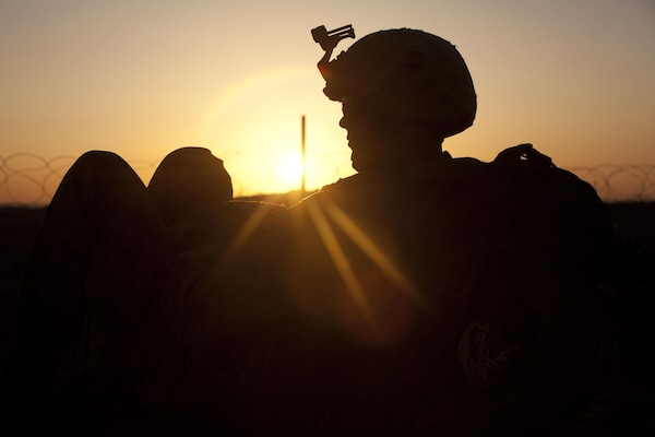 Lance Cpl. Joseph Marshall, a squad automatic weapon gunner with Fox Company, 2nd Battalion, 3rd Marine Regiment, waits for the sun to rise in Southern Marjah District, Helmand province, Afghanistan, March 23, the first day of Operation Watchtower. Marshall is from Glenallen, Alaska.