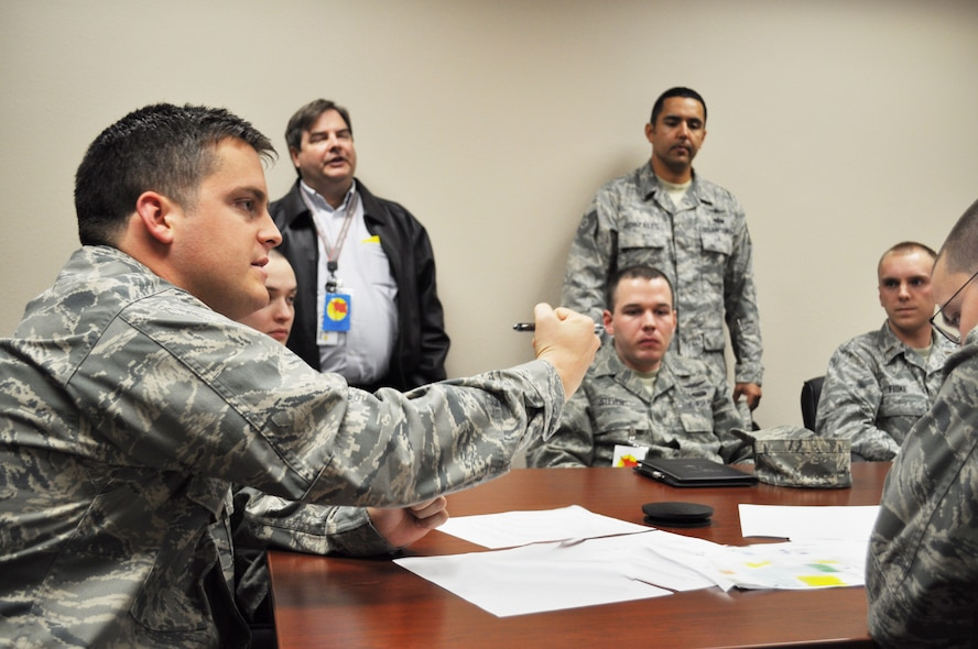 1st Lt. Nathan Kane, 26th Network Operations Squadron, talks during the Red Flag blue team debrief at Lackland Air Force Base March 7. Lieutenant Kane acted as a network defender during the exercise. This was the first time cyber operators had an active role on the blue team. (Photo illustration by Tech. Sgt. Scott McNabb)