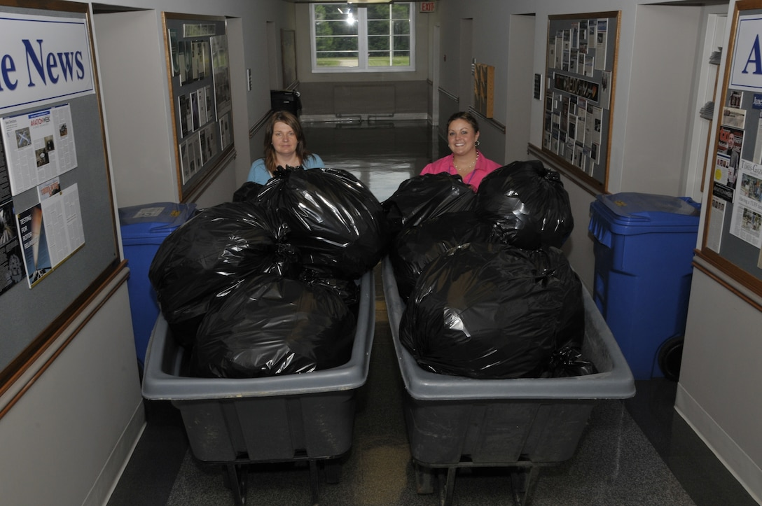 ATA employees Vickie Seals (left) and Andrea Stephens (right) prepare to deliver materials to the certified Cintas driver as part of the recent bulk shred day, June 18. (Photo by: Rick Goodfriend)