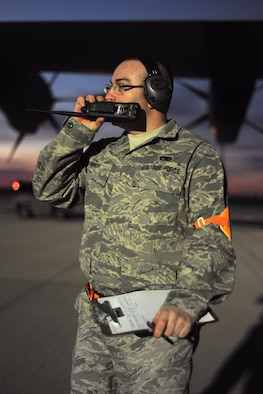 SPANGDAHLEM AIR BASE, Germany – An Airman assigned to the 726th Air Mobility Squadron relays information about an outgoing C-130J Super Hercules here in support of Operation Odyssey Dawn March 21. Joint Task Force Odyssey Dawn is the U.S. Africa Command task force established to provide operational and tactical command and control of U.S. military forces supporting the international response to the unrest in Libya and enforcement of United Nations Security Council Resolution (UNSCR) 1973. UNSCR 1973 authorizes all necessary measures to protect civilians in Libya under threat of attack by Qadhafi regime forces.  JTF Odyssey Dawn is commanded by U.S. Navy Admiral Samuel J. Locklear, III. (U.S. Air Force photo/Senior Airman Nathanael Callon)