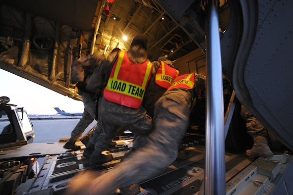 SPANGDAHLEM AIR BASE, Germany – Airmen from the 726th Air Mobility and 52nd Logistics Readiness Squadrons load cargo into a C-130J Super Hercules here in support of Odyssey Dawn March 21. Joint Task Force Odyssey Dawn is the U.S. Africa Command task force established to provide operational and tactical command and control of U.S. military forces supporting the international response to the unrest in Libya and enforcement of United Nations Security Council Resolution (UNSCR) 1973. UNSCR 1973 authorizes all necessary measures to protect civilians in Libya under threat of attack by Qadhafi regime forces.  JTF Odyssey Dawn is commanded by U.S. Navy Admiral Samuel J. Locklear, III. (U.S. Air Force photo/Senior Airman Nathanael Callon)
