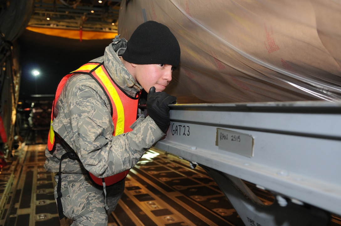 SPANGDAHLEM AIR BASE, Germany –A 52nd Logistics Readiness Squadron Airman pushes cargo into a C-130J Super Hercules here in support of Operation Odyssey Dawn March 20. Joint Task Force Odyssey Dawn is the U.S. Africa Command task force established to provide operational and tactical command and control of U.S. military forces supporting the international response to the unrest in Libya and enforcement of United Nations Security Council Resolution (UNSCR) 1973. UNSCR 1973 authorizes all necessary measures to protect civilians in Libya under threat of attack by Qadhafi regime forces.  JTF Odyssey Dawn is commanded by U.S. Navy Admiral Samuel J. Locklear, III. (U.S. Air Force photo/Airman 1st Class Matthew B. Fredericks)