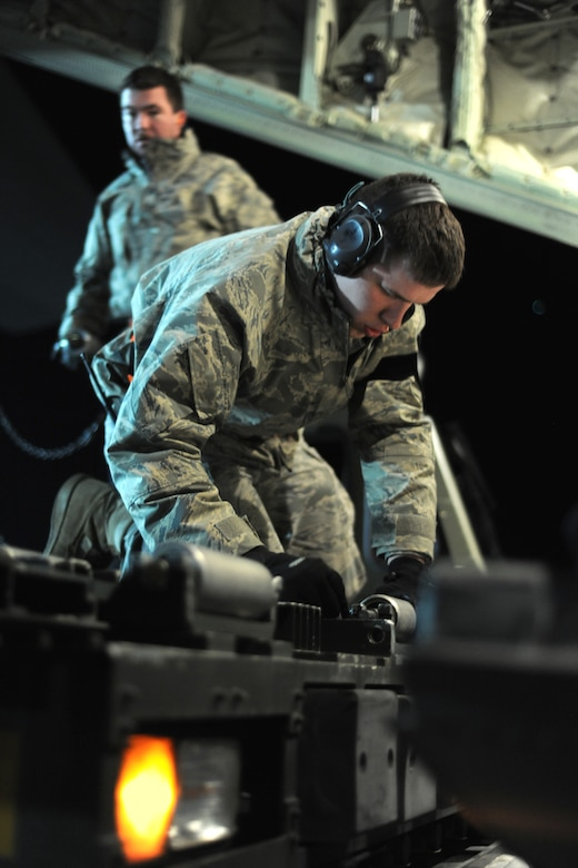SPANGDAHLEM AIR BASE, Germany – An Airman from the 726th Air Mobility Squadron prepares to load cargo onto a C-130J Super Hercules here in support of Operation Odyssey Dawn March 20. Joint Task Force Odyssey Dawn is the U.S. Africa Command task force established to provide operational and tactical command and control of U.S. military forces supporting the international response to the unrest in Libya and enforcement of United Nations Security Council Resolution (UNSCR) 1973. UNSCR 1973 authorizes all necessary measures to protect civilians in Libya under threat of attack by Qadhafi regime forces.  JTF Odyssey Dawn is commanded by U.S. Navy Admiral Samuel J. Locklear, III. (U.S. Air Force photo/Senior Airman Nathanael Callon)
