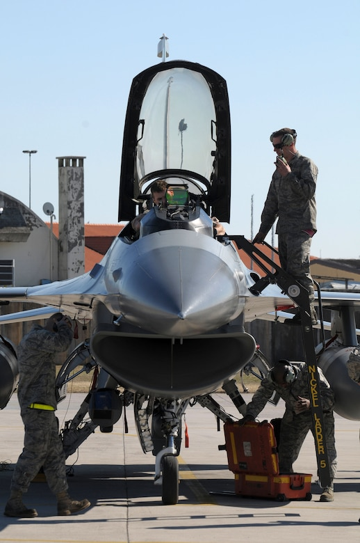 U.S. Air Force F-16 Fighting Falcon flight crew members perform post-flight checks on Aviano Air Force Base, Italy, after the F-16 pilot returns from supporting Joint Task Force Odyssey Dawn on March 20, 2011. Joint Task Force Odyssey Dawn is the U.S. Africa Command task force established to support the larger international response to the unrest in Libya.  A broad coalition of nations are partnering to enforce U.N. Security Council Resolution (UNSCR) 1973, which authorizes all necessary means to protect civilians in Libya under threat of attack by Qadhafi regime forces.  JTF Odyssey Dawn is commanded by Admiral Samuel J. Locklear, III.  (US Army Photo by SSG Tierney P. Wilson)