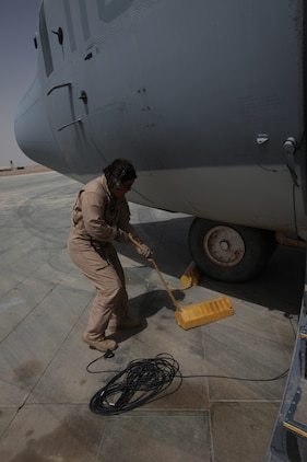 Cpl. Jessica M. Egan, a crew chief with Marine Aerial Refueler Transport Squadron 352, performs a preflight inspection on the Harvest Hawk equipped KC-130J at Camp Dwyer, Afghanistan, March 25. The one-of-a-kind Harvest Hawk system includes a version of the target sight sensor used on the AH-1Z Cobra attack helicopter as well as a complement  of four AGM-114 Hellfire and 10 Griffin missiles.
