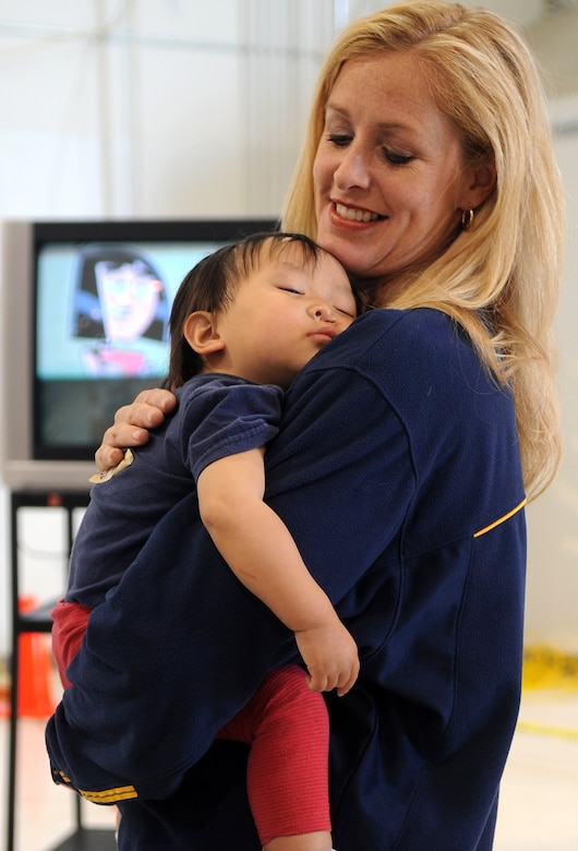 Buckley Air Force Base, Colo- Heather Tidwell volunteered during Operation Pacific Passage March 25, 2011. Mrs.Tidwell offered to help take care of some of the children returning home while their parents could in-process upon arriving home from Japan (U.S. Air Force photo by Airman 1st Class Marcy Glass)