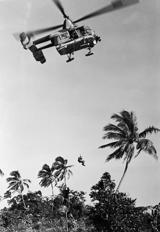HH-43 Pedro hoisting a pilot in Southeast Asia. (U.S. Air Force photo)