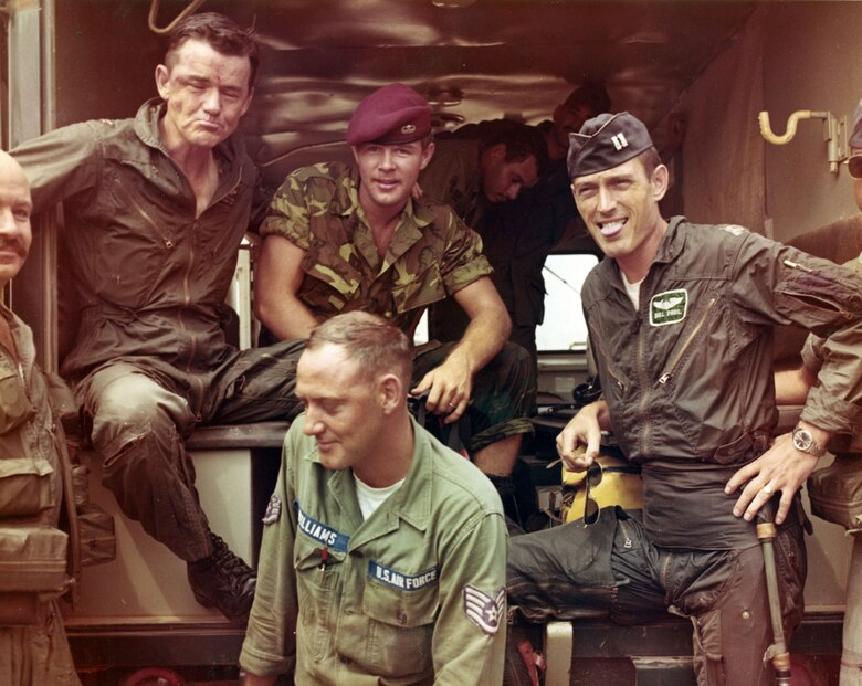 Col. (later Maj. Gen.) Robert Maloy (left) and Capt. William S. Paul (right) of the 366th Tactical Fighter Wing after being rescued by an H-3E Jolly Green Giant from the 37th Aerospace Rescue and Recovery Squadron on Oct. 15, 1967.  Enemy fire hit their F-4 Phantom over North Vietnam, but they reached open water before ejecting.  Maloy fractured his back, and Pararescueman (PJ) Airman 1st Class Roger Klenovich (center, wearing red PJ beret) went into the water to help him. (U.S. Air Force photo)