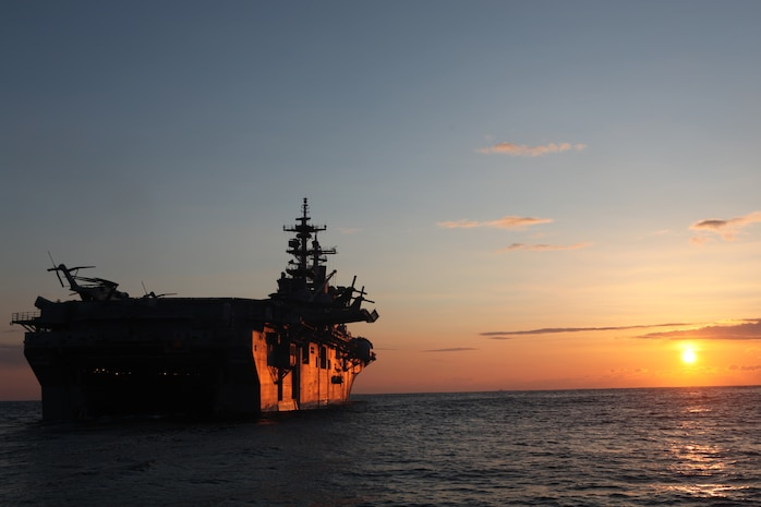 The USS Essex (LHD 2), with the 31st Marine Expeditionary Unit aboard, nears the coast of Japan at sunrise, March 27.  The 31st MEU and Amphibious Squadron 11 delivered food, water, comfort items and commercial repair vehicles to residents on the isolated island of Oshima using U.S. Navy landing craft, demonstrating the MEU's expeditionary capabilities in ship-to-shore amphibious operations. Marines and Sailors of the 31st MEU are conducting humanitarian aid and disaster relief missions in northeast Japan in coordination with the Japanese Self Defense Forces.