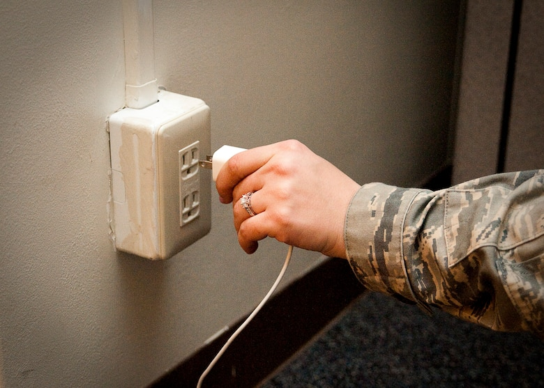YOKOTA AIR BASE, Japan -- Unplugging electronics when not in use is one way to conserve energy. To help reduce demand on Japan's power grid, Yokota personnel are encouraged to save energy by turning off lights, unplugging appliances and conservatively using facility heating, ventilation and air conditioning systems. (U.S. Air Force photo/Airman 1st Class Andrea Salazar)