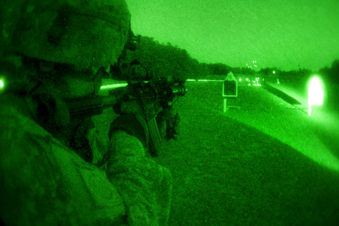 As seen through a night-vision device, a U.S. Army paratrooper uses night-vision goggles and a PEQ-15 laser to fire his M-4 carbine at targets during night-fire training on Fort Bragg, N.C., March 23, 2011.
