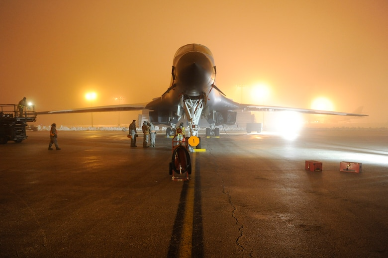 Airmen of the 28th Aircraft Maintenance Squadron prepare a B-1B Lancer to support Operation Odyssey Dawn on Ellsworth Air Force Base, S.D., March 27, 2011.   Their work was made especially difficult by severe weather, including four inches of snow; glare ice, and freezing fog. (U.S. Air Force photo/Staff Sgt. Marc I. Lane)