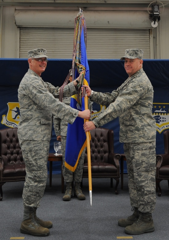 Col. Erik Hansen accepts the 437th Airlift Wing guide-on from Lt. Gen. Robert Allardice at the 437 AW change of command ceremony, March 22 on Joint Base Charleston. Colonel Hansen is the 437 AW commander and General Allardice is the 18th Air Force commander. (U.S. Air Force photo/Senior Airman Timothy Taylor)
