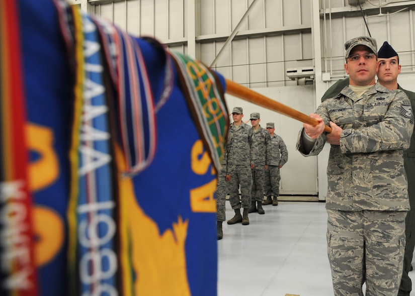 Master Sgt. Randall Fontenot salutes with the guidon during the 437th Airlift Wing Change of Command ceremony March 29 on Joint Base Charleston, S.C. Master Sergeant Fontenot is the 437th Operations Support Squadron first sergeant. (U.S. Air Force photo/Staff Sgt. Katie Gieratz)