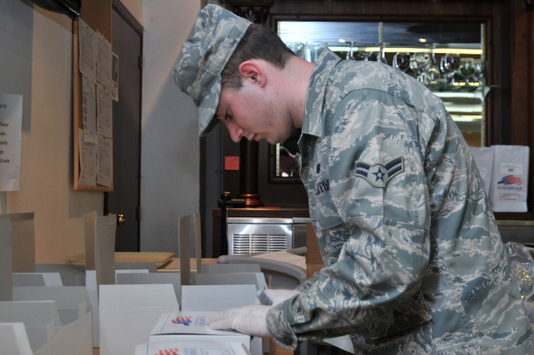 313th AIR EXPEDITIONARY WING -- Airman 1st Class Justin Sullivan, a flight kitchen employee from Spangdahlem Air Base, Germany, prepares flight meals in support of Joint Task Force Odyssey Dawn March 30. Joint Task Force Odyssey Dawn is the U.S. Africa Command task force established to provide operational and tactical command and control of U.S. military forces supporting the international response to the unrest in Libya and enforcement of United Nations Security Council Resolution (UNSCR) 1973. UNSCR 1973 authorizes all necessary measures to protect civilians in Libya under threat of attack by Gadhafi regime forces. JTF Odyssey Dawn is commanded by U.S. Navy Admiral Samuel J. Locklear, III. (U.S. Air Force photo/Senior Airman David Dobrydney/Unreleased)