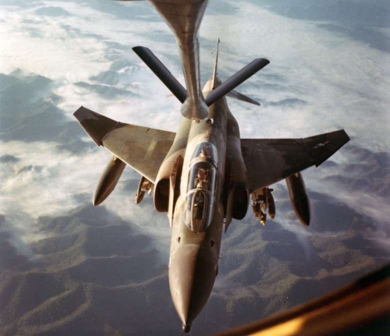 Refueling an F-4 Phantom over rugged Southeast Asian terrain, as seen from the KC-135 boom operator's point of view, 1967. (U.S. Air Force photo)