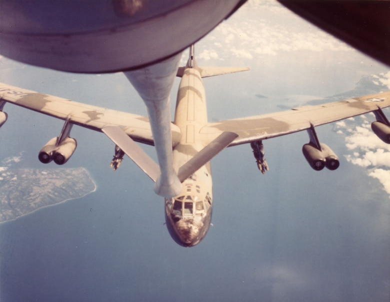 A B-52 refuels over Southeast Asia in 1967. Refueling bombers over vast expanses of ocean required precise navigation and planning. (U.S. Air Force photo)