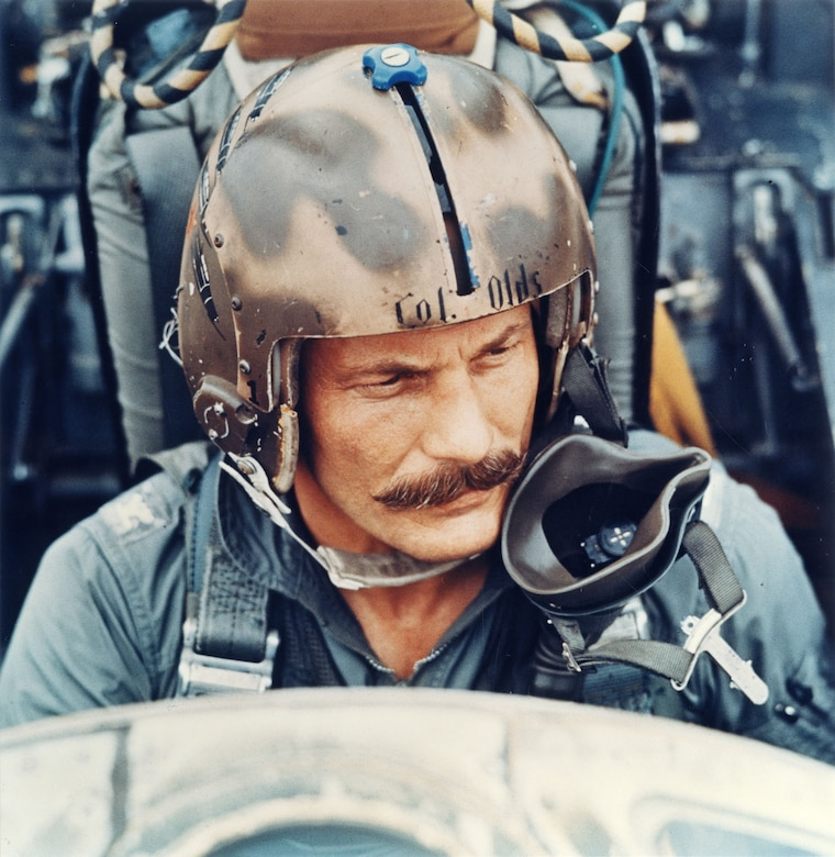 Col. Robin Olds wearing the flight helmet that is on display in the Southeast Asia War Gallery at the National Museum of the U.S. Air Force. (U.S. Air Force photo)