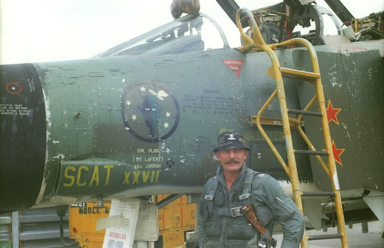 Col. Robin Olds with his F-4C SCAT XXVII, which is on display at the National Museum of the U.S. Air Force. Olds named all his aircraft after his West Point roommate Scat Davis, who could not become a military pilot due to poor eyesight. (U.S. Air Force photo)
