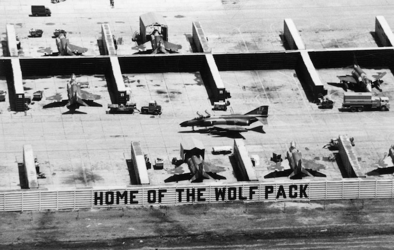 "The nickname of the 8th Tactical Fighter Wing -- the ""Wolfpack"" -- fit Robin Olds' aggressive style. Pictured here are revetments and F-4s of the 8th TFW at Ubon, Thailand. (U.S. Air Force photo)"