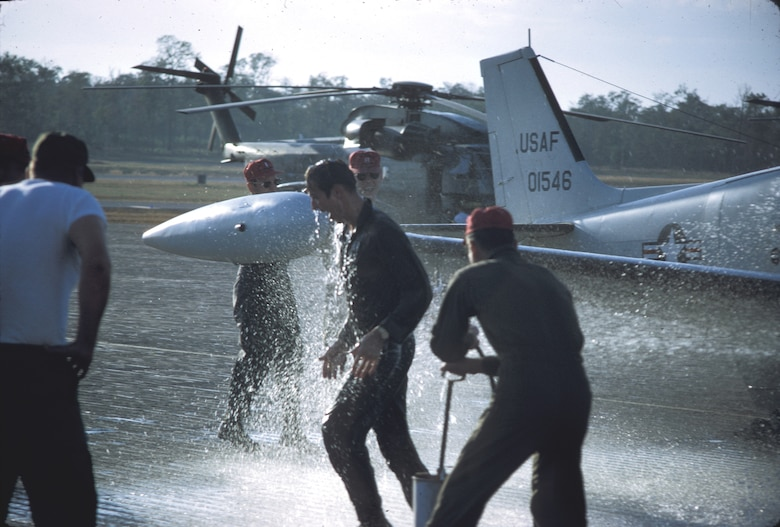 "A U.S. Air Force pilot gets a traditional ""hose-down"" after his last mission over the Trail. (U.S. Air Force photo)."