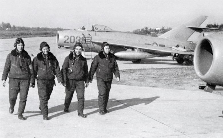 North Vietnamese Air Force MiG-17 pilots walk by their aircraft. (U.S. Air Force photo)