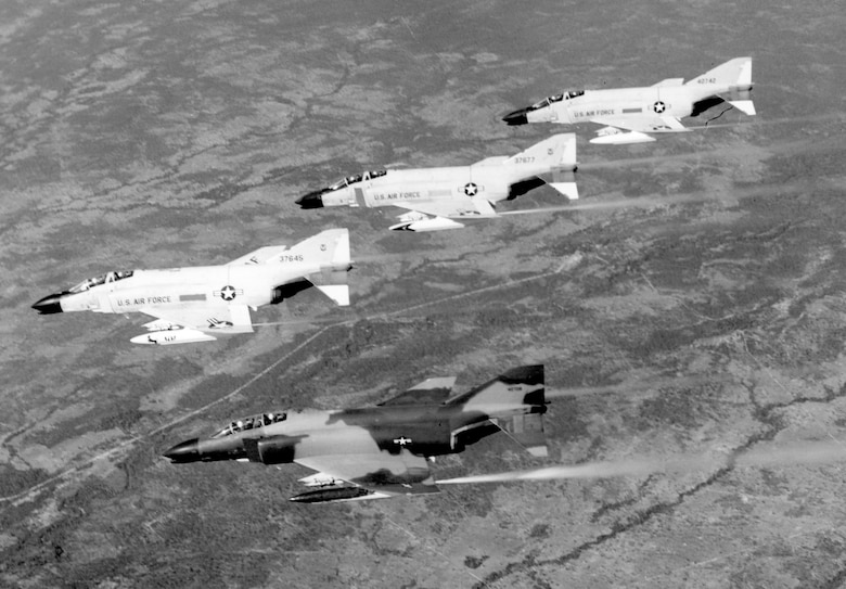 Early F-4s in Southeast Asia were painted gray, but by 1966, they were camouflaged like the Phantom at the bottom of the photograph. (U.S. Air Force photo)