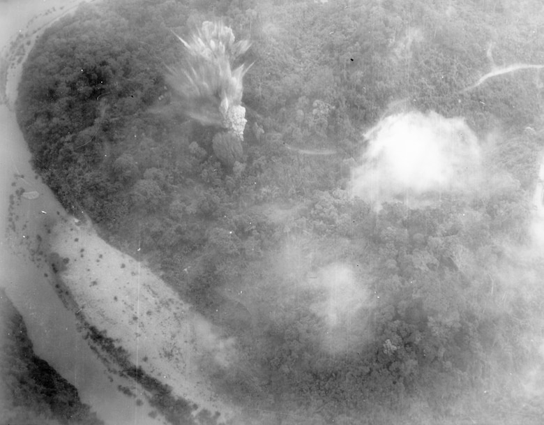 Bombs explode on a truck park near the Mu Gia Pass, the key crossing between North Vietnam and Laos. The U.S. Air Force bombed key points on the Ho Chi Minh Trail. (U.S. Air Force photo).