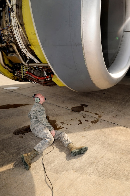 313TH AIR EXPEDITIONARY WING -- A 92nd Aircraft Maintenance Squadron jet mechanic from Fairchild Air Force Base, Wash., inspects a KC-135 engine here during an engine run in support of Joint Task Force Odyssey Dawn March 26. Joint Task Force Odyssey Dawn is the U.S. Africa Command task force established to provide operational and tactical command and control of U.S. military forces supporting the international response to the unrest in Libya and enforcement of United Nations Security Council Resolution (UNSCR) 1973. UNSCR 1973 authorizes all necessary measures to protect civilians in Libya under threat of attack by Gadhafi regime forces. JTF Odyssey Dawn is commanded by U.S. Navy Admiral Samuel J. Locklear, III. (U.S. Air Force photo/Senior Airman Ethan Morgan)