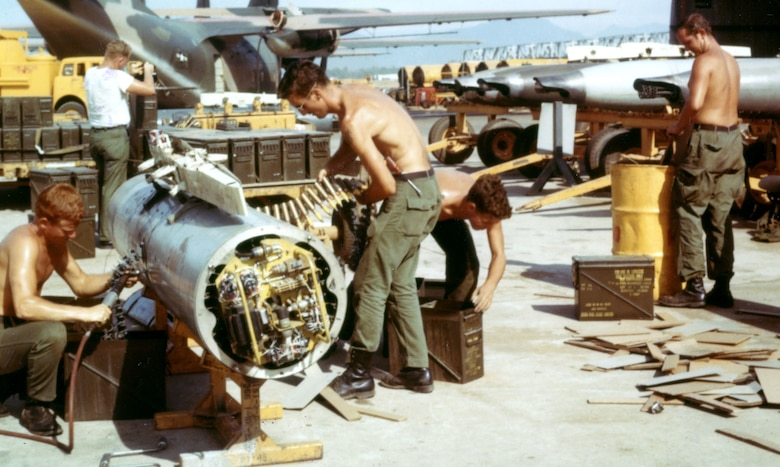 F-4Cs and F-4Ds did not have an internal gun. Some were equipped with an external gun pod. Here, armorers load 20mm cannon rounds into an F-4 gun pod. In the upper right corner are several complete gun pods. (U.S. Air Force photo