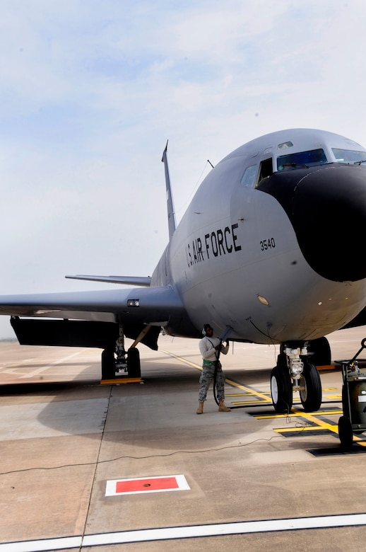 313TH AIR EXPEDITIONARY WING --  A 22nd Aircraft Maintenance Squadron crew chief, deployed from McConnell Air Force Base, Kan., plugs a generator power cable into a KC-135 Stratotanker here March 25 in support of Joint Task Force Odyssey Dawn. Joint Task Force Odyssey Dawn is the U.S. Africa Command task force established to provide operational and tactical command and control of U.S. military forces supporting the international response to the unrest in Libya and enforcement of United Nations Security Council Resolution (UNSCR) 1973. UNSCR 1973 authorizes all necessary measures to protect civilians in Libya under threat of attack by Gadhafi regime forces. JTF Odyssey Dawn is commanded by U.S. Navy Admiral Samuel J. Locklear, III. (U.S. Air Force photo/Senior Airman Ethan Morgan)