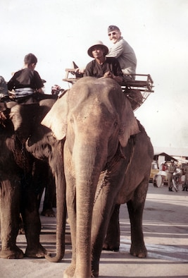 """In addition to the very serious business of developing better tactics, the """"practice reunions"""" also involved parades, lots of humor and fraternal events. Here, Col. Robin Olds rides an elephant from the flightline to the officer's club. (U.S. Air Force photo)"""