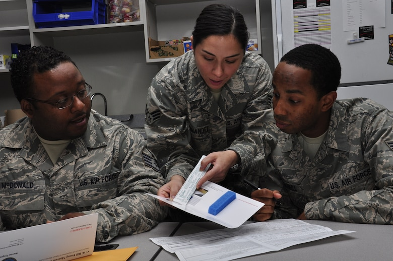 Senior Airman Eguzki Fernandez (center) instructs Staff Sgt. Anthony McDonald  and Senior Airman Kenneth McNeill, on how to fill out registration forms during a week-long bone marrow drive, Hurlburt Field, Fla., March 30, 2011. All are from the 1st Special Operations Communications Squadron Tactical Communications Flight. The base-wide drive, initiated by the 1st SOCS, helps support their colleague, Senior Master Sgt. Andy Turnbull, Tactical Communications Flight superintendent, who was diagnosed with acute myeloid leukemia July 19, 2010. (U.S. Air Force photo by Staff Sgt. William Banton/RELEASED)